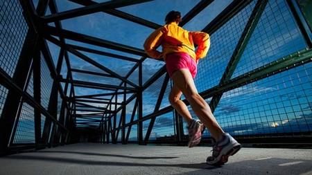 A woman jogging on a bridge