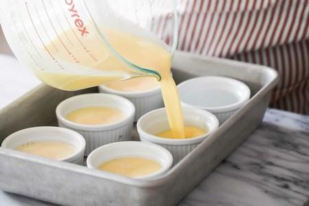 Vanilla Bean Creme Brulee divide custard between ramekins