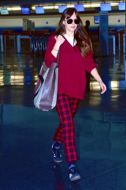 Dakota Johnson strolls through JFK Airport