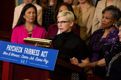 Actress Michelle Williams, center, speaks during a news conference for Equal Pay Day in Washington, D.C., U.S., on Tuesday, April 2, 2019. Women in the U.S. earn on average 81 percent of what men do, a fact commemorated Tuesday by what's come to be called 'Equal Pay Day' -- the day to which a woman has to work to earn as much as a man did in the previous year. Photographer: Anna Moneymaker/Bloomberg via Getty Images
