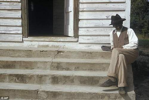A man in a syphilis study sits on steps in front of of a house in Tuskegee, in the 1950s. The city had one of the highest rates in the country when doctors decided to start the racist study