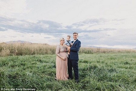 The couple are pictured with their first son Urban, one, while Markie was pregnant with Everly