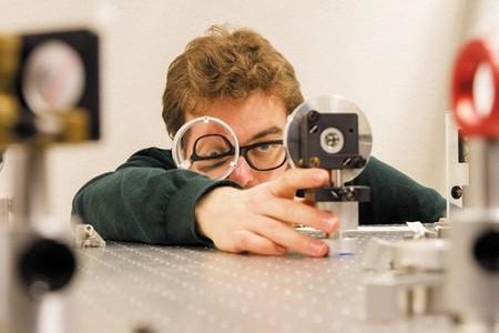 Man looking through a lens
