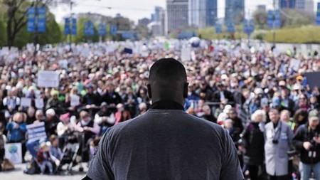Man making a speech to a crowd