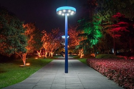 The blue light which comes from smartphones, tablets and LED street lights (stock image) may help to cause cancer, researchers warn