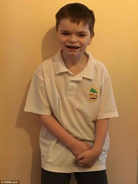 Sam Pearson (believed to be pictured after the procedure) has been cured of an ultra-rare condition that affects just 50 children worldwide due to a pioneering 'brain transplant'