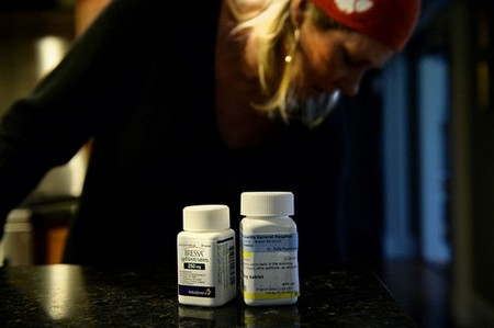 A woman with her cancer medication