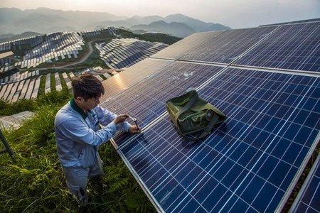 A worker works at Chinese photo-voltaic power station