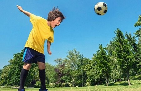 Heading footballs may cause brain injuries, new research suggests (stock)