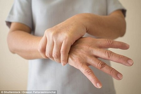 A non-invasive nerve stimulator reduces hand tremors by nearly 90 percent (stock)