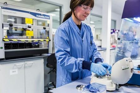 Scientist working in the Almac Diagnostics Laboratory