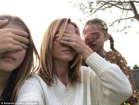 Amanda Holden shared a selfie of herself covering her eyes, along with her daughtersHollie and Alexa. The starsargue the only ad-blocker children currently have is covering their eyes