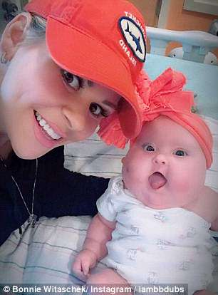 The infant, pictured with her mother Bonnie, was born with Down's syndrome, three heart defects, an intestinal defect and an endocrine disorder in September