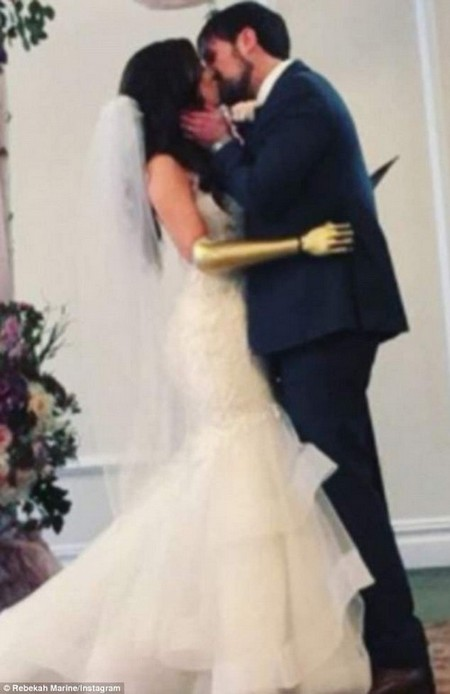 Happily ever after:A model born without a forearm just got married wearing a gold prosthetic hand after she's been wearing the same black bionic limb for almost 20 years