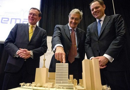 Guido Rasi, director of the European Medicines Agency, points to a model of the new headquarters in Amsterdam