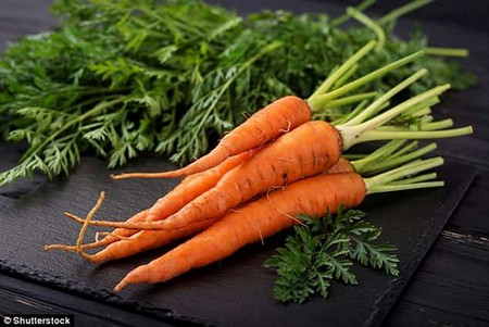 Scientists found raw vegetables, such as carrots and spinach, are better for mental health than those which are cooked, tinned or processed