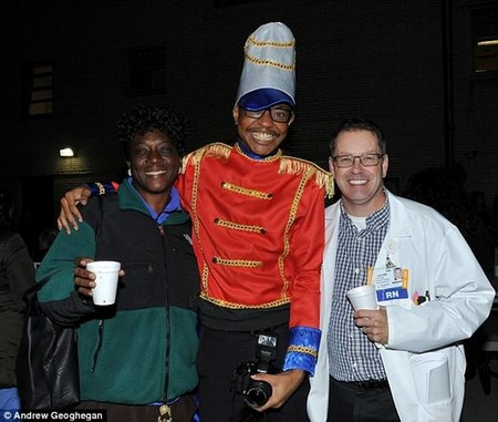 On the night an aneurysm ruptured in his brain, Billy Brogdon-Simmons  (center) was enjoying his co-workers, dressed as a toy soldier at a tree-lighting for the hospital where he worked