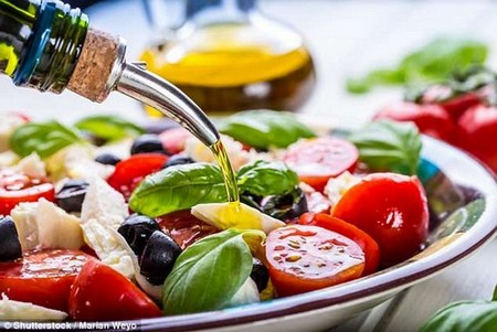 Following a Mediterranean diet may delay dementia, new research suggests (stock)