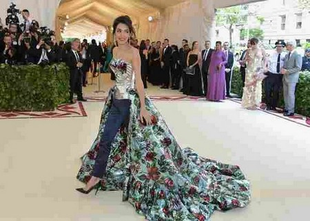 NEW YORK, NY - MAY 07: Amal Clooney attends the Heavenly Bodies: Fashion & The Catholic Imagination Costume Institute Gala at The Metropolitan Museum of Art on May 7, 2018 in New York City. (Photo by Neilson Barnard/)
