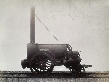 Black and white photograph of an early steam engine, Stephenson's 'Rocket', c1905.