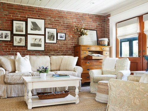 "Black-and-white family photographs hang on the living room wall, keeping happy memories of Patrick Kennedy's childhood alive and well in the home. His wife, Amy, describes her family's primary residence in Brigantine, New Jersey, as ""a little bit more formal, so we said, 'Up here I really want to be comfortable. I want a couch I can sleep on, lay down, and it feels relaxed.'"" Slipcovered furniture, she knew, was key to maintaining that easygoing feeling. Trinkets found in the garage belonging to Patrick's father, Ted, gained new meaning and were placed around the house, like a cigar box for his favorite kind of cigar. ""Once you lose your parents, the decision of what to keep and what to let go of becomes harder,"" says Amy."