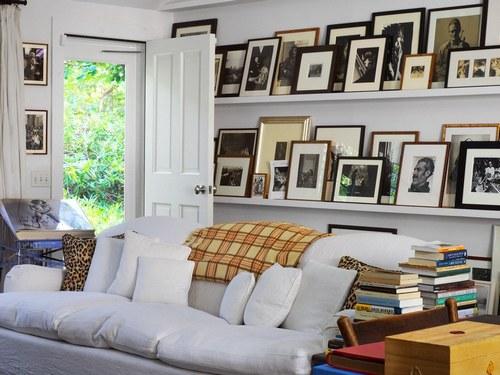 A George Sherlock sofa slipcovered in white linen.