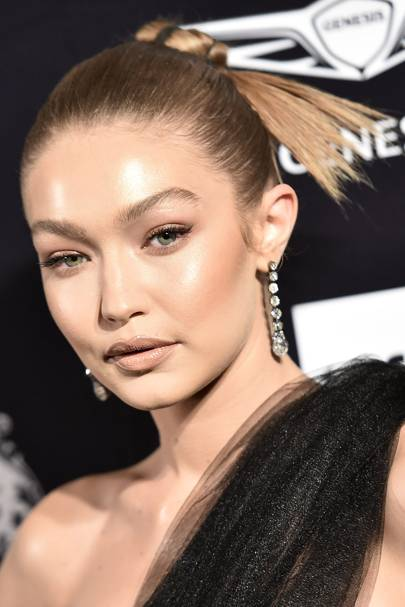 Slicked-back hair is THE style of the season, here's the quirky product Gigi Hadid uses to achieve the look