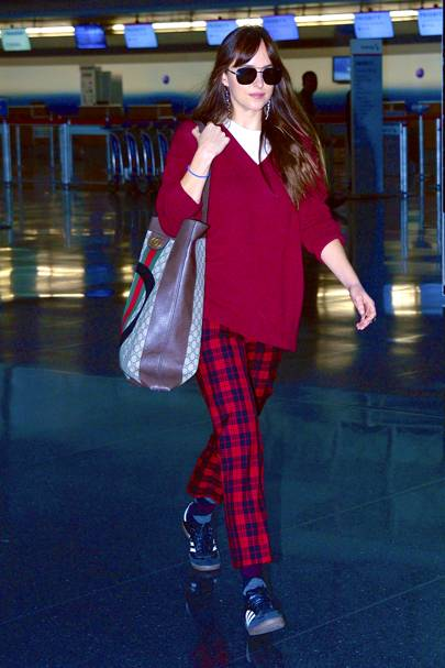 Dakota Johnson strolls through JFK Airport
