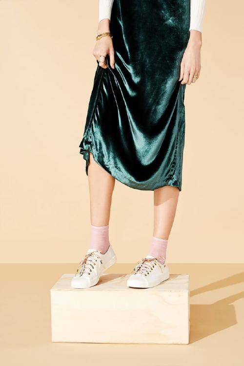Who says an elegant ensemble can't also be functional? Featuring rich emerald and luxe velvet, this look can effortlessly take you from desk to dinner (and beyond) without skipping a beat. Highlight these versatile yet not-so-basic white sneakers by slipping into complementary socks that are meant for showing off. Kickstart Meadow Sneakers ($70)