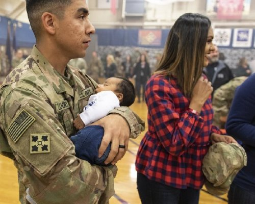 Soldier's first moment with family…just in time for the holidays