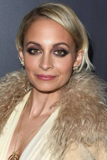 Nicole Richie is the master of smoky eyeshadow. She loves to rock a shimmering metallic look, and pares down the makeup with a subtle lip.