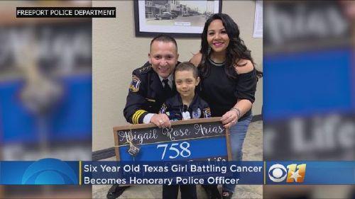 Girl battling cancer sworn, in as honorary police officer