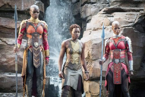 BLACK PANTHER, from left: Danai Gurira, Lupita Nyong'o, Florence Kasumba, 2018. ph: Matt Kennedy / Marvel / Walt Disney Studios Motion Pictures /Courtesy Everett Collection