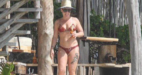 Pink Kicks Back, and Relaxes With a Beer During, a Romantic Beach Getaway With Carey Hart
