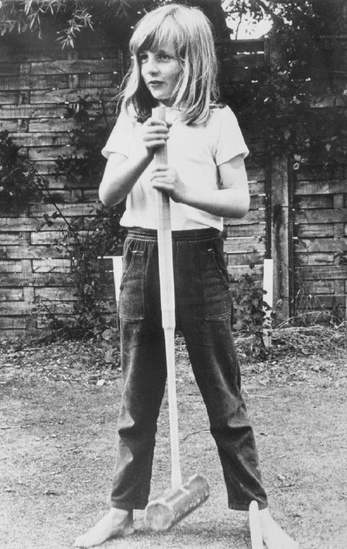 (Original Caption) Little Lady Diana. Itchenor, England: Lady Diana Spencer is to be 20 July 1. She and Britain's Prince Charles are to marry. In this picture, taken in summer, 1970, a barefoot Lady Diana poses with a croquet mallet while on holiday in Itchenor, West Sussex.