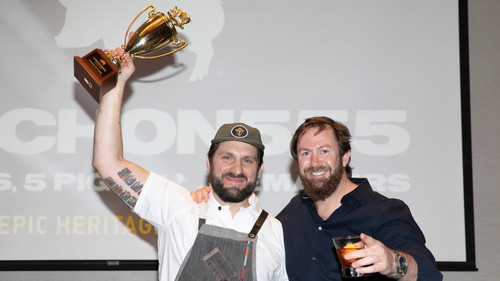 """Chef Gabe Erales of Comedor (holding trophy) and Cochon555 founder Brady Lowe. Chef Erales earned the """"Prince of Pork"""" title and will represent Austin at Grand Cochon, the national finale, on September 15 in Chicago."""