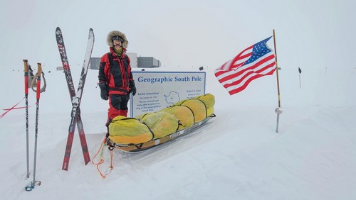 The American made a brief stop at the geographic South Pole before continuing on with his journey alone.
