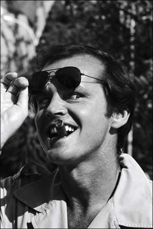 Jack Nicholson sports a pair of classic Ray-Ban aviators with his trademark grin and cigar.