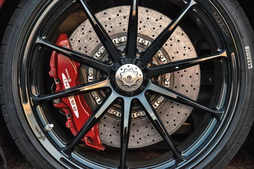 Striking red brake calipers give an indication of what Pagani hypercars are capable of.