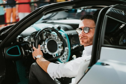 Brett David at the wheel of a Pagani during the Miami Design District Concours