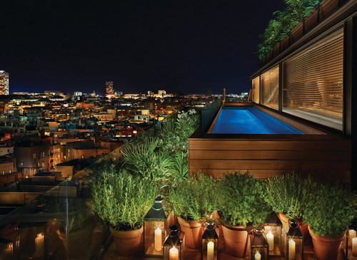 Gaze out over the city as it comes alive at night while taking a swim at Barcelona Edition.