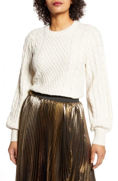 white cable-knit sweater