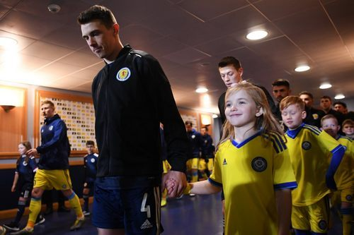 GLASGOW, SCOTLAND - NOVEMBER 19: Ryan Jack (L) of Scotland and Player escort kids smile in the tunnel prior to the UEFA Euro 2020 qualifier between Scotland and Kazakhstan at Hampden Park on November 19, 2019 in Glasgow, Scotland. (Photo by Oliver Hardt - UEFA/UEFA via Getty Images)